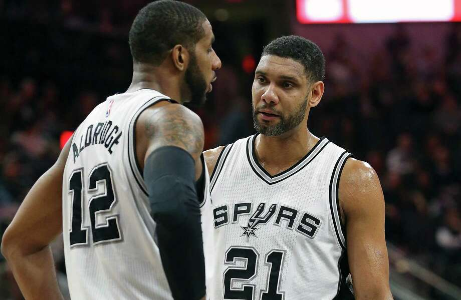 LaMarcus Aldridge and Tim Duncan chat during a time out as the Spurs host the Cavaliers at the AT&T Center on Jan.14, 2016. Photo: Tom Reel /San Antonio Express-News / 2016 SAN ANTONIO EXPRESS-NEWS