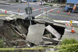 A sinkhole at the intersection of Rheem Boulevard and Center Street is seen on Monday, March 14, 2016 in Moraga, California.