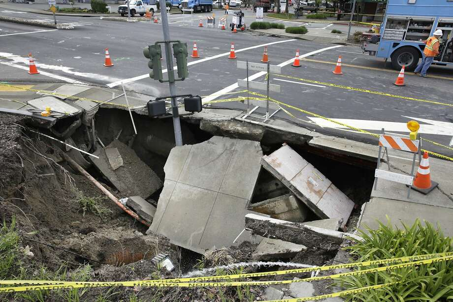 A sinkhole at the intersection of Rheem Boulevard and Center Street is seen on Monday, March 14, 2016 in Moraga, California. Photo: Lea Suzuki, The Chronicle