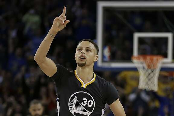 Golden State Warriors' Stephen Curry celebrates a score against the Phoenix Suns during the second half of an NBA basketball game Saturday, March 12, 2016, in Oakland, Calif. (AP Photo/Ben Margot)