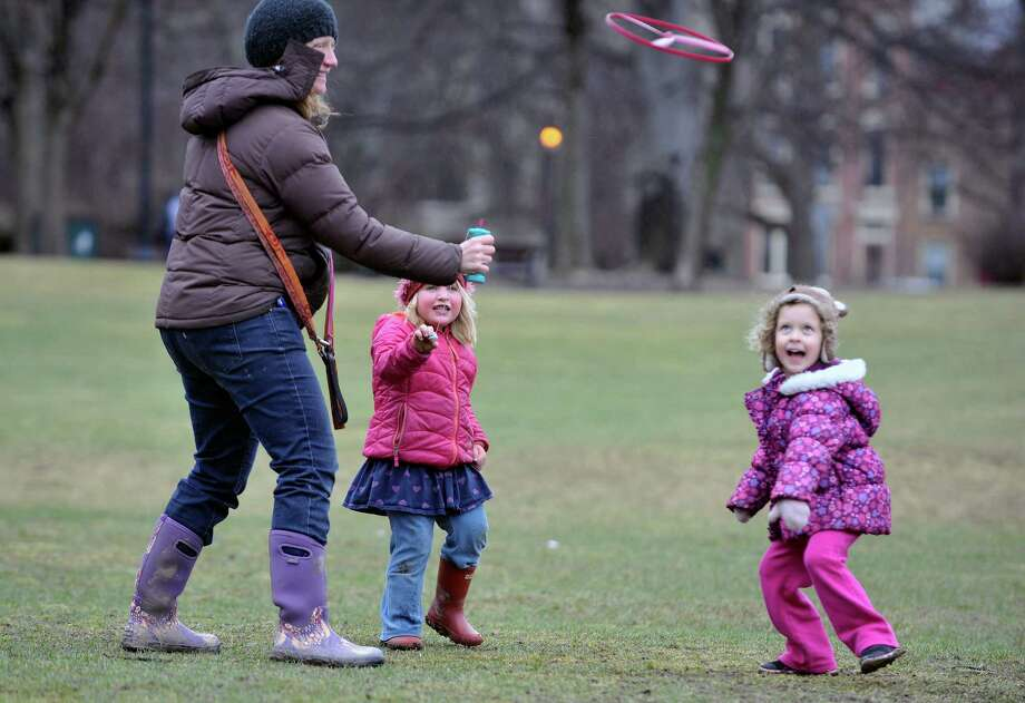 Leah Akins, left, of Albany, her daughter, Flora Schlesinger, 4, and Flora's friend, Zora Miller-Solot, 4, play with a toy Zora gave Flora for her birthday on Monday, March 14, 2016, in Albany, N.Y.  Monday was Flora's birthday.  (Paul Buckowski / Times Union)