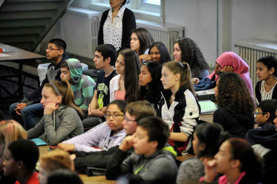 """Seventh and eighth graders at Mont Pleasant Middle School take part in math and science events with staff from the Colleges of Nanoscale Science and Engineering at SUNY Polytechnic Institute during Pi Day on Monday, March 14, 2016, in Schenectady, N.Y.  SUNY Poly is starting a new Pi Day tradition where their """"Pi Patrol"""" vehicles will deliver educational, Pi-themed activities and pizza pies students at local middle schools.   (Paul Buckowski / Times Union) Photo: PAUL BUCKOWSKI / 10035814A"""