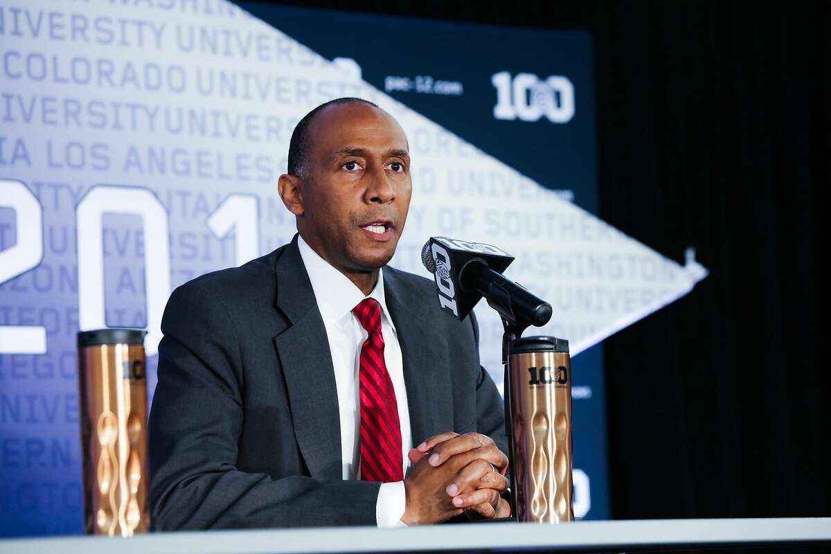 Stanford Coach Johnny Dawkins answers questions from the media in regards to the upcoming season, at the Pac -12 men's basketball media day in San Francisco, California on Thursday, October 15, 2015.