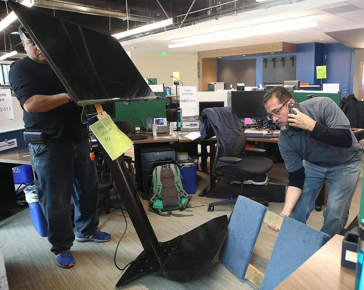 Movers Cheliz Ramos (left) and Walter Guirola (right)move a monitor to the new LinkedIn headquarters at 222 2nd St. in San Francisco, California, on Monday, march 14, 2016.