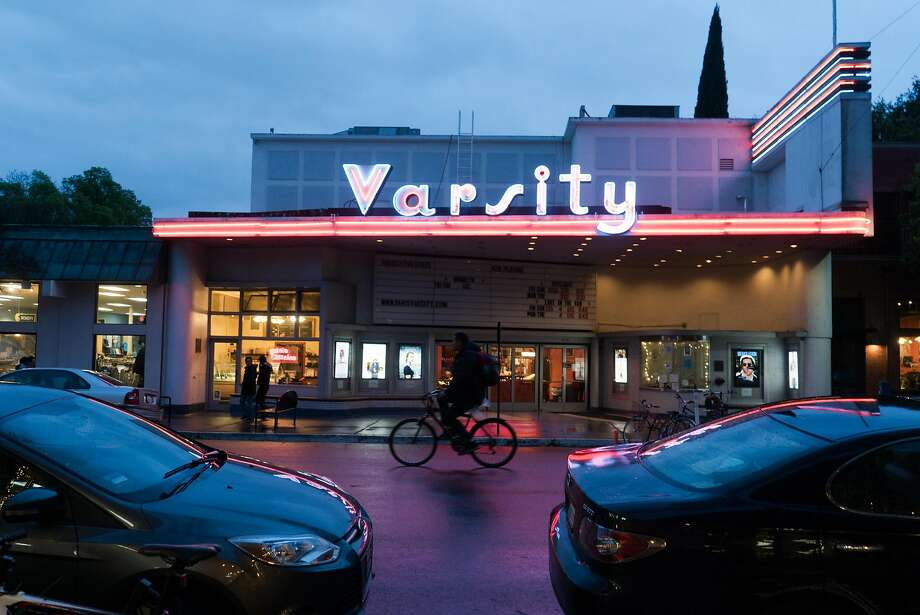 A man bikes past the Varsity Theater in downtown Davis, Calif. on Friday, March 11, 2016. Davis offers activities for cyclists, diners and nature enthusiasts. Photo: James Tensuan, Special To The Chronicle