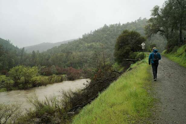 A man walks by the Blue Ridge Trail in Yolo County, Calif. on Saturday, March 12, 2016. Hikes such as the Blue Ridge Trail offer great views of the valley.