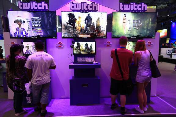Visitors stream online computer games on the Twitch Interactive Inc. stand at Gamescom video games trade fair in Cologne, Germany, on Wednesday, Aug. 13, 2014. The world's largest video-game fair is set to draw a record attendance this week as visitors seek out titles for new consoles from Microsoft Corp. and Sony Corp. Photographer: Krisztian Bocsi/Bloomberg