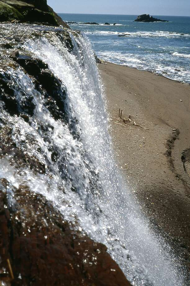 At the brink: Alamere Falls flows over a cliff and to the beach below at the southern end of Point Reyes National Seashore in western Marin County Photo: Tom Stienstra, Tom Stienstra / The Chronicle