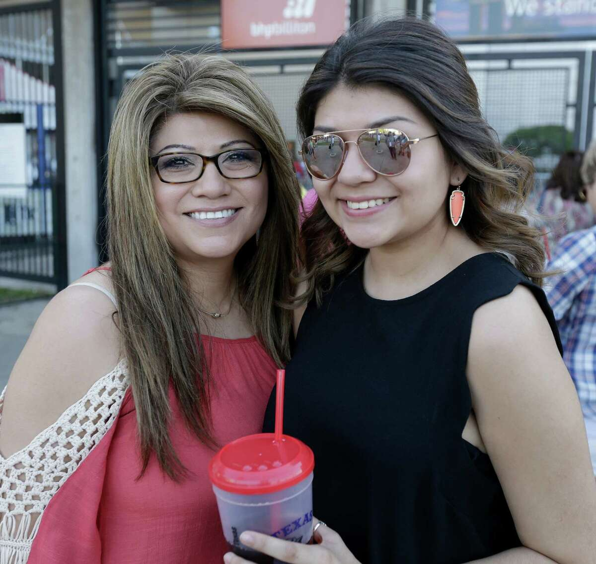 People pose for a photo as they wait in line to enter NRG Stadium for RodeoHouston where Kenny Chesney will perform during the Houston Live Stock and Rodeo Monday, March 14, 2016, in Houston.