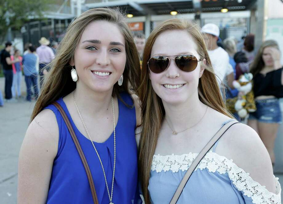 People pose for a photo as they wait in line to enter NRG Stadium for RodeoHouston where Kenny Chesney will perform during the Houston Live Stock and Rodeo Monday, March 14, 2016, in Houston. Photo: Melissa Phillip, Houston Chronicle / © 2016 Houston Chronicle
