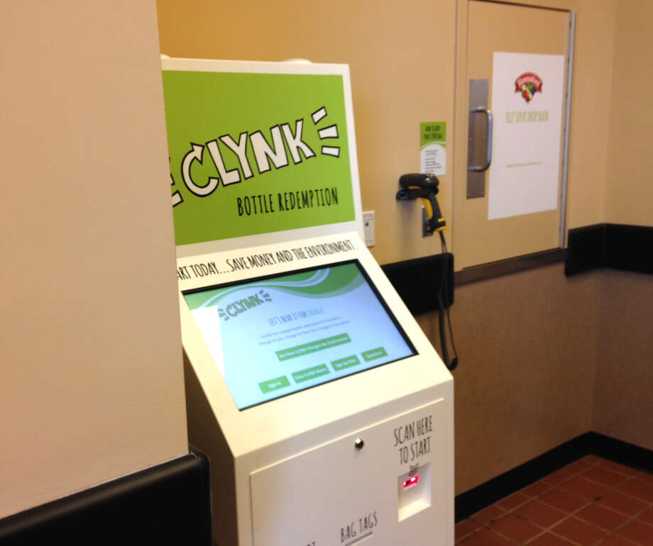 A CLYNK recycling kiosk at Hanford supermarket is shown during a launch of their new recycling program on Monday, March 14, 2016, in Colonie, N.Y. Hannaford customers can go to a store with a bag of recyclables, scanning a tag that identifies their personal account or a charity they designate, and then dropping the bag through a door into a room where Hannaford employees scan them. The first 10 bags are free. After that, it's $1.75. Charities receive 100 bags. The program was launched Monday at the Latham store but will expand to others. (Tim O'Brien/Times Union) Photo: Will Waldron