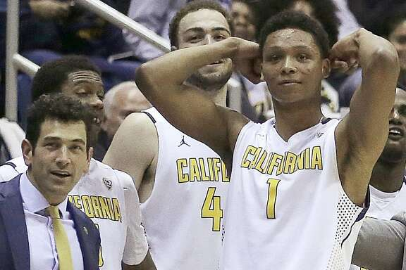 FILE - In this Feb. 11, 2016, file photo California assistant basketball coach Yann Hufnagel, left, is seen on the bench with players Kameron Rooks, center, and Ivan Rabb (1) during an NCAA college basketball game against Oregon in Berkeley, Calif. The team's head coach is moving to fire Hufnagel who violated the school's sexual harassment policy. It comes as the university has faced criticism for its handling of substantiated sexual harassment allegations involving an astronomy professor and the dean of Berkeley's law school. The athletic department said in a statement Monday that Hufnagel has been suspended pending termination proceedings. He won't be traveling with the team during the upcoming NCAA Men's Basketball Tournament. (AP Photo/Ben Margot, File)
