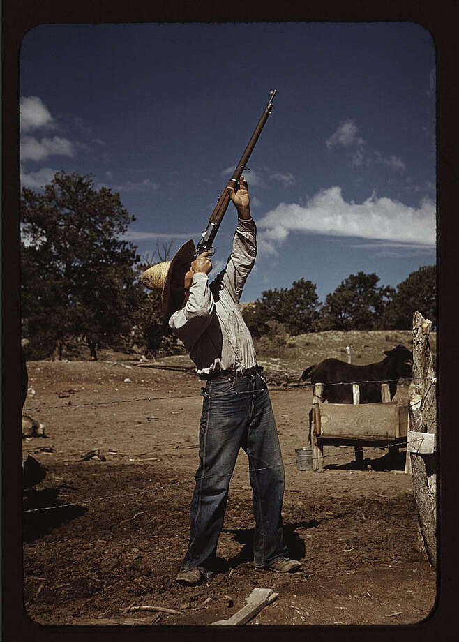 """Original caption reads: """"Mr. Leatherman, homesteader, shooting hawks which have been carrying away his chickens, Pie Town, New Mexico."""" Photo dated October 1940, by Russell Lee. Photo: Farm Security Administration — Office Of War Information Collection, Library Of Congress / 2016 Public Domain"""