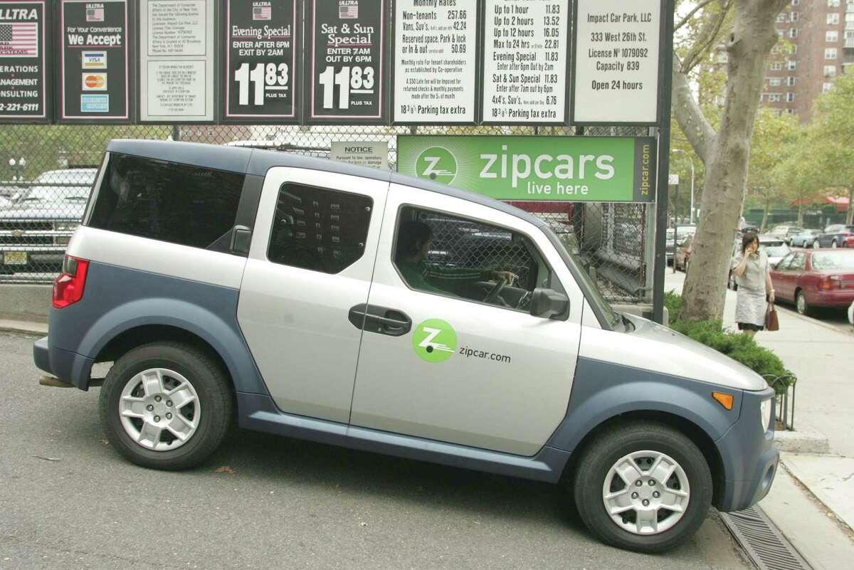 Rolling in a Zipcar. (AP Photo/Hiroko Masuike) ORG XMIT: NYHM112