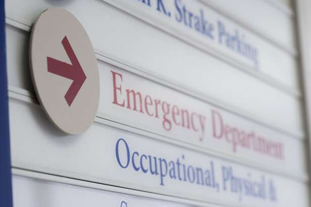 File photo of generic hospital emergency room. Close up of sign for emergency department in hospital