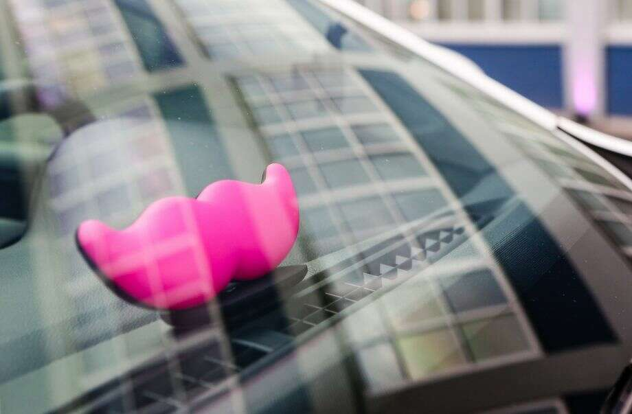Lyft drivers cars are identified by the distinctive pink mustache. Photo: Amy Osborne,  The Chronicle