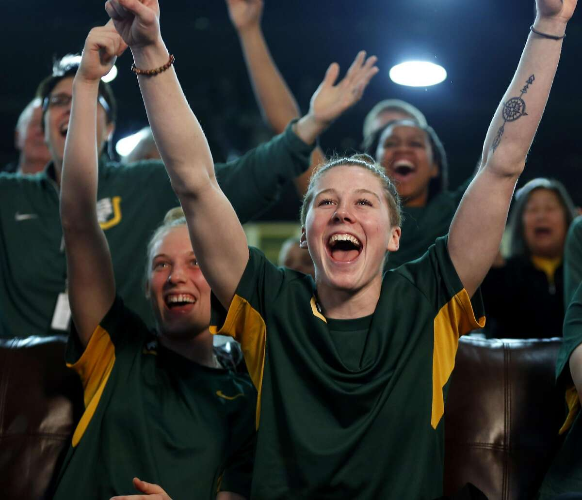 USF women's basketball player Rachel Howard cheers with her teammates after learning their seed in the NCAA Women's Basketball tournament while at a viewing party at War Memorial at the Sobrato Center at USF in San Francisco, California, on Monday, March 14, 2016.