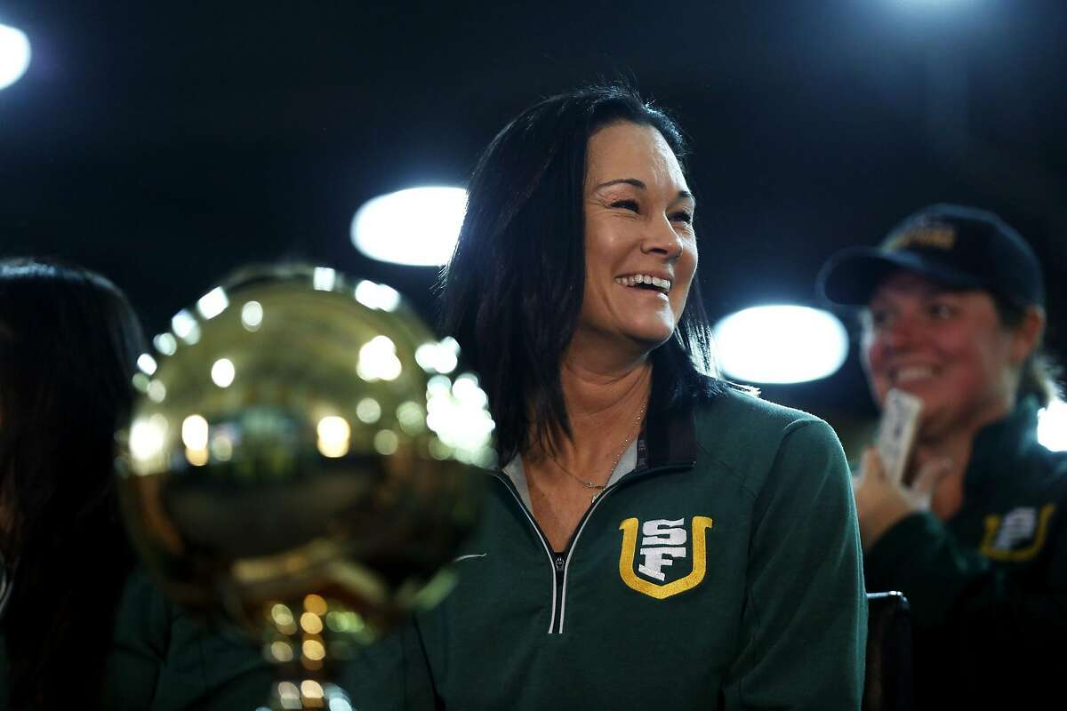 USF Women's Basketball head coach Jennifer Azzi laughs after learning the team's seed in the NCAA Women's Basketball tournament while at a viewing party at War Memorial at the Sobrato Center at USF in San Francisco, California, on Monday, March 14, 2016.