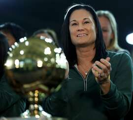 USF Women's Basketball head coach Jennifer Azzi claps after learning the team's seed in the NCAA Women's Basketball tournament while at a viewing party at War Memorial at the Sobrato Center at USF in San Francisco, California, on Monday, March 14, 2016.