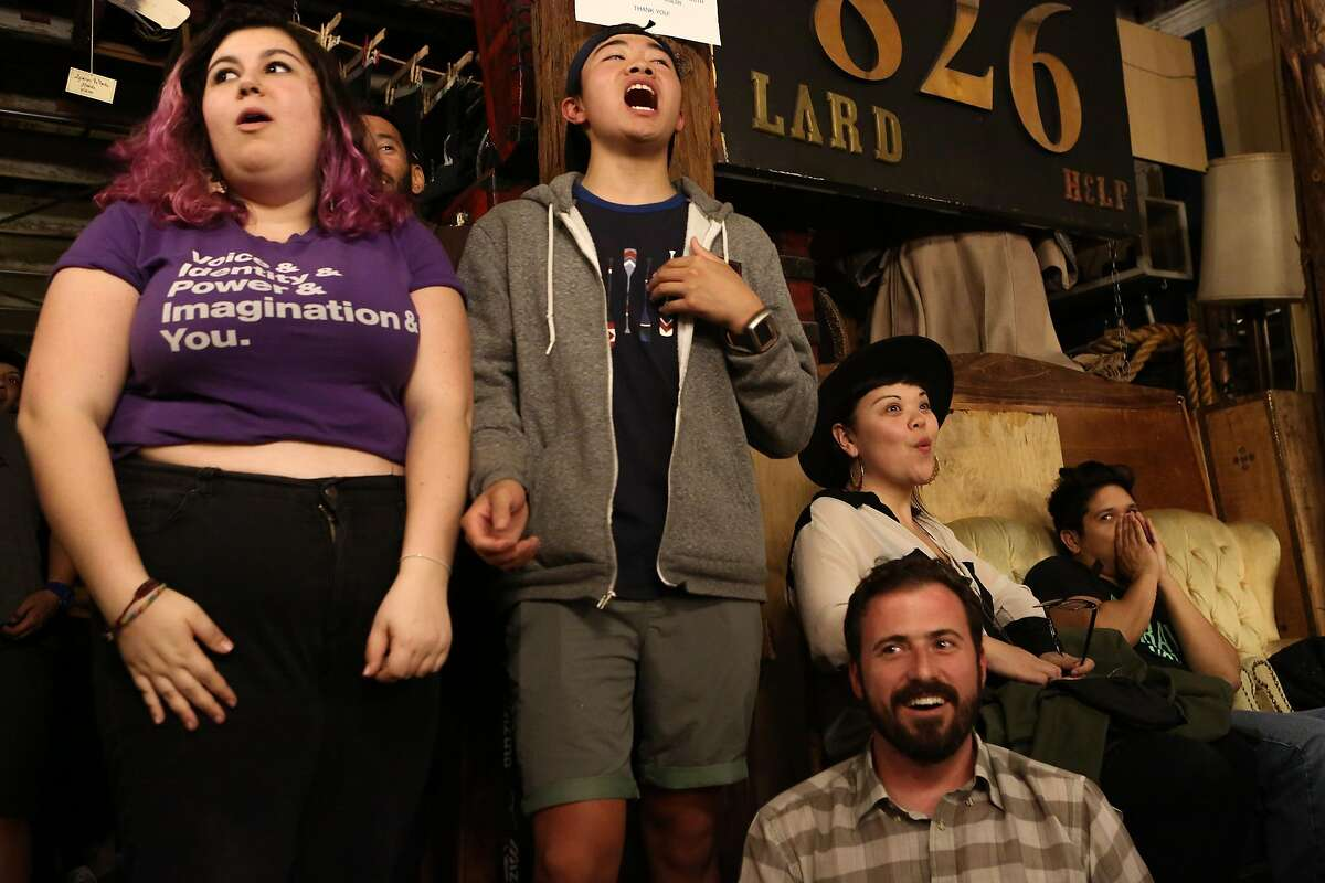 Youth Speaks members Rose Gelfand, 17, and Brandon Yip, 18, react to the announcement that there will be a tiebreaker at the Youth Speaks Teen Poetry Slam in San Francisco, Calif. on Friday, Feb. 27, 2016.