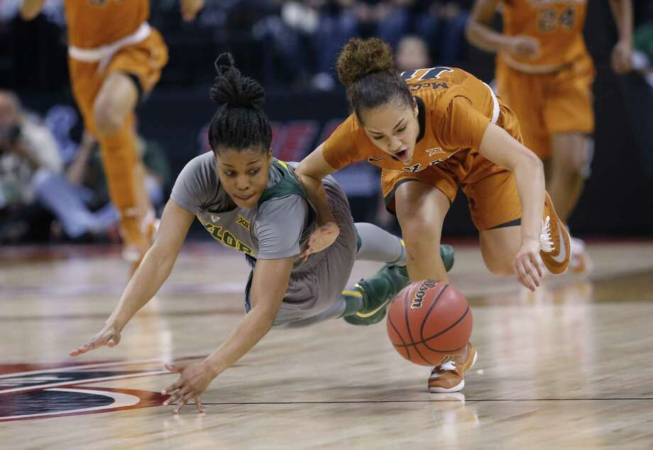 Baylor guard Niya Johnson, left, and Texas guard Brooke McCarty, right, chase a loose ball in the third quarter of an NCAA college basketball championship game in the Big 12 women's tournament in Oklahoma City, Monday, March 7, 2016. Photo: Sue Ogrocki /AP / AP