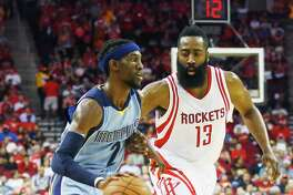 HOUSTON, TX - MARCH 14:  Briante Weber #2 of the Memphis Grizzlies drives with the basketball in front of James Harden #13 of the Houston Rockets during their game at the Toyota Center on March 14, 2016 in Houston, Texas.