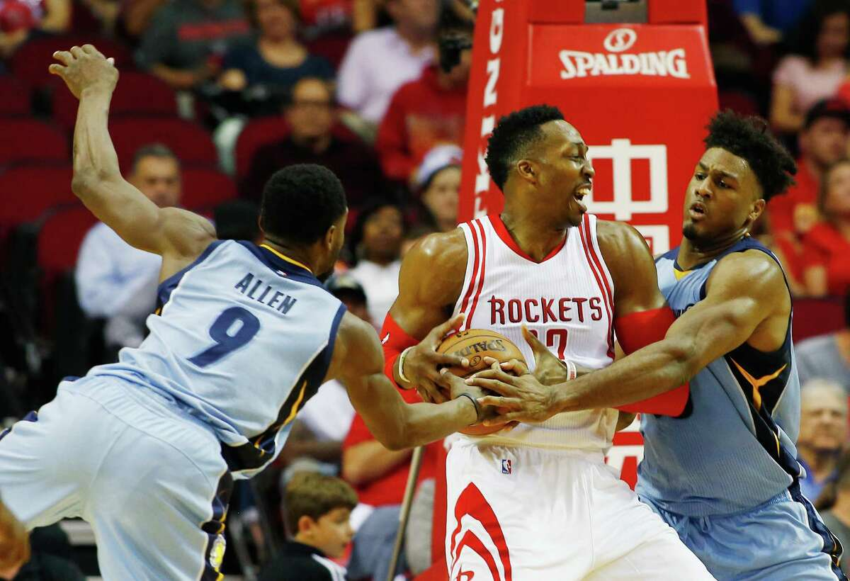 HOUSTON, TX - MARCH 14: Tony Allen #9 and Alex Stepheson #35 of the Memphis Grizzlies defend against Dwight Howard #12 of the Houston Rockets during their game at the Toyota Center on March 14, 2016 in Houston, Texas.