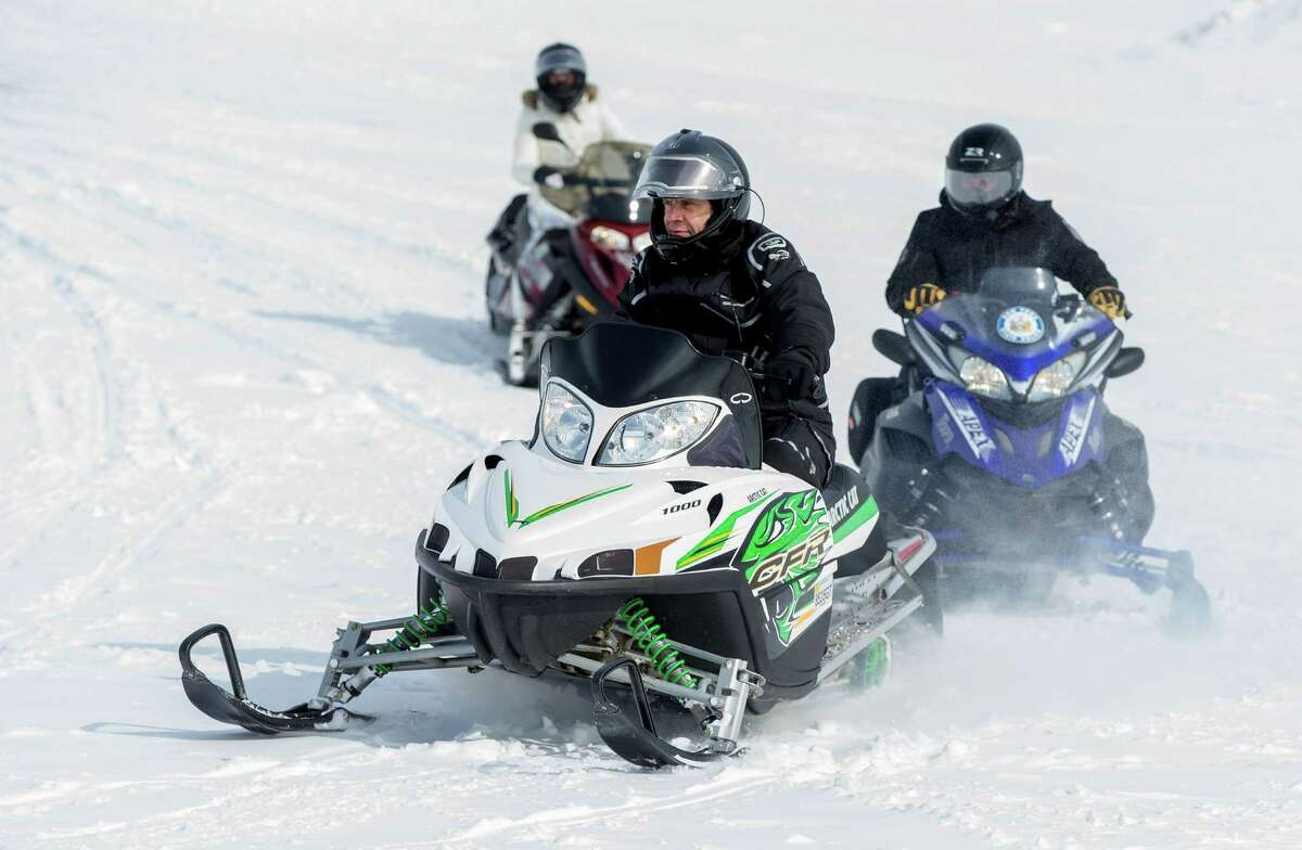 Governor Andrew M. Cuomo goes snowmobiling during an announcement to promote winter tourism on Thursday, Feb. 19, 2015, in Lowville, N.Y. (Office of the Governor)