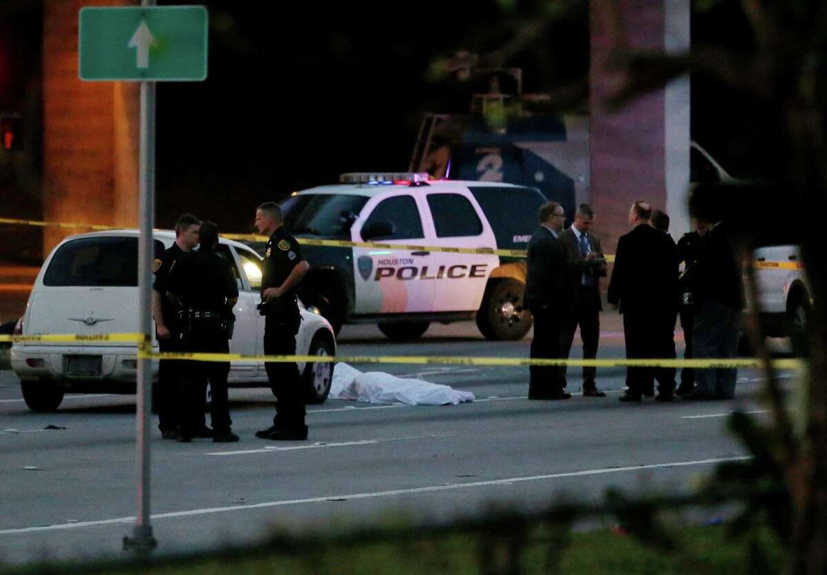 Houston police investigate one of three fatal officer-involved shootings, this one at the intersection of Collingsworth Street and the Eastex Freeway on Saturday.