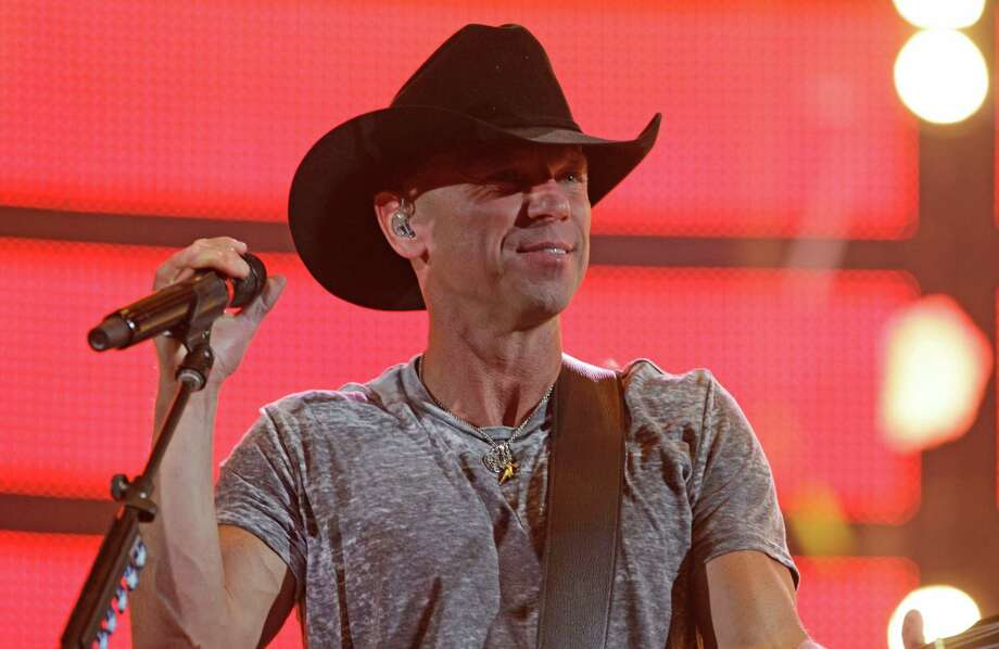 Kenny Chesney eases into his set Monday and shows some love for his fans at the Houston Livestock Show and Rodeo at NRG Stadium. Chesney last performed in Houston in May at BBVA Compass Stadium, with a set nearly identical to Monday's lineup. However, his last appearance at RodeoHouston was in 2013. Photo: Melissa Phillip, Staff / © 2016 Houston Chronicle