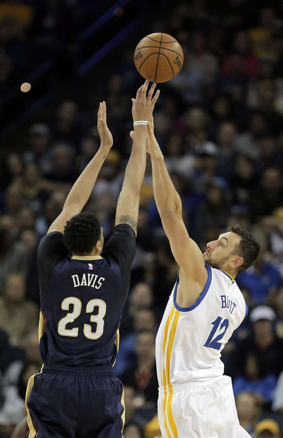 Andrew Bogut (12) defends against Anthony Davis (23) in the first half as the Golden State Warriors played the New Orleans Pelicans at Oracle Arena in Oakland, Calif., on Monday, March 14, 2016.