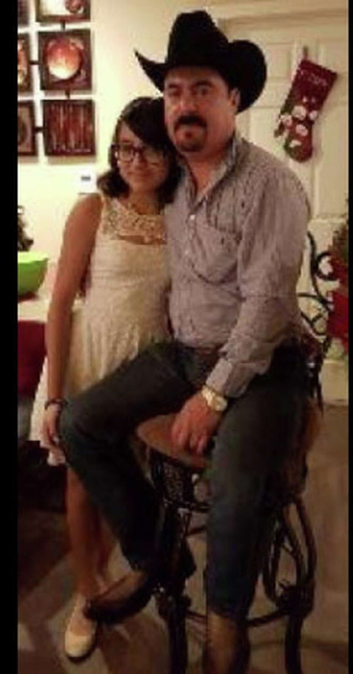 Missing 14-year-old Adriana Coronado with her father, Caesar Coronado, who was found dead in an apparent homicide Sunday.