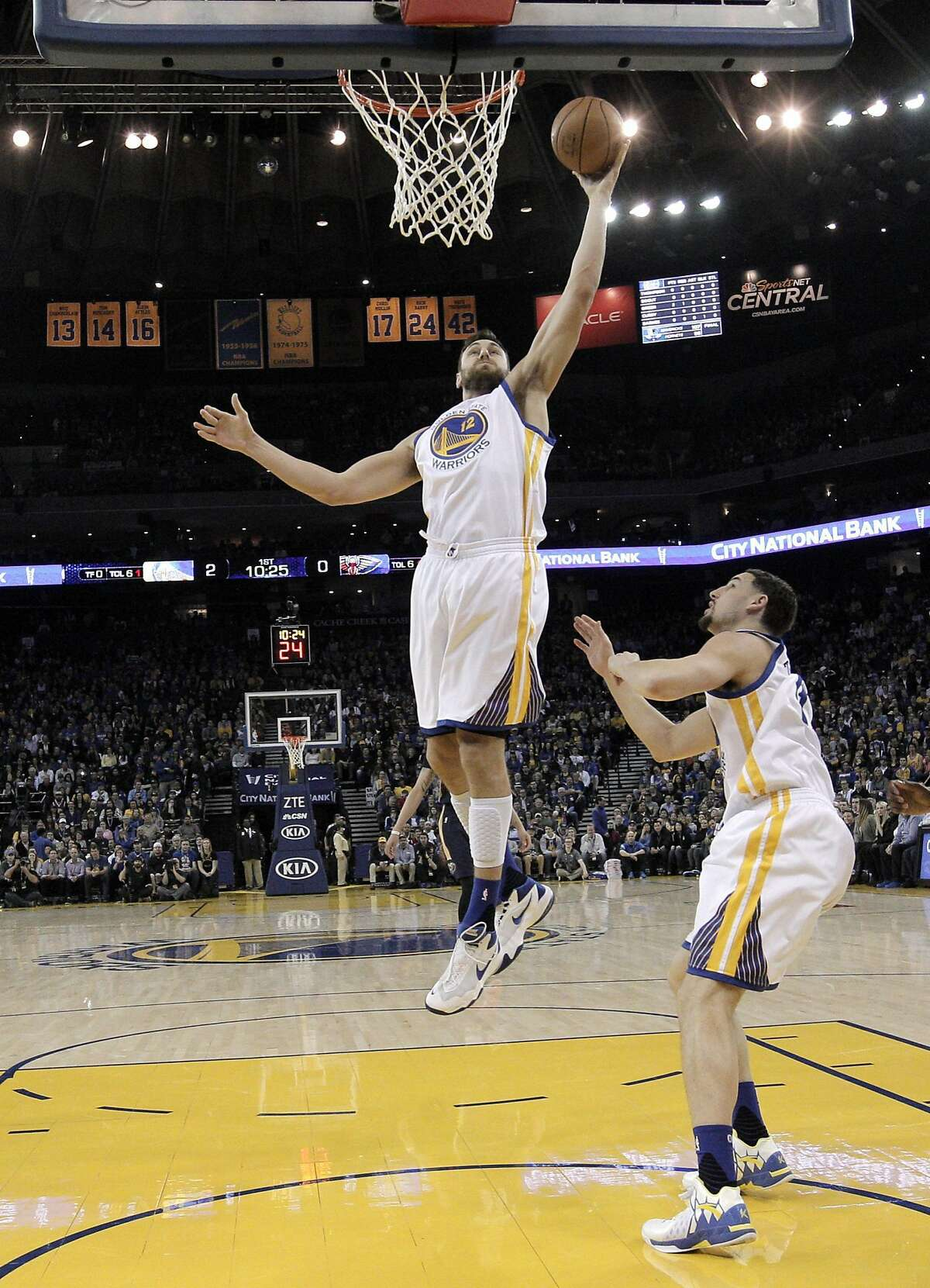 Andrew Bogut (12) grabs a rebound in the first half as the Golden State Warriors played the New Orleans Pelicans at Oracle Arena in Oakland, Calif., on Monday, March 14, 2016.