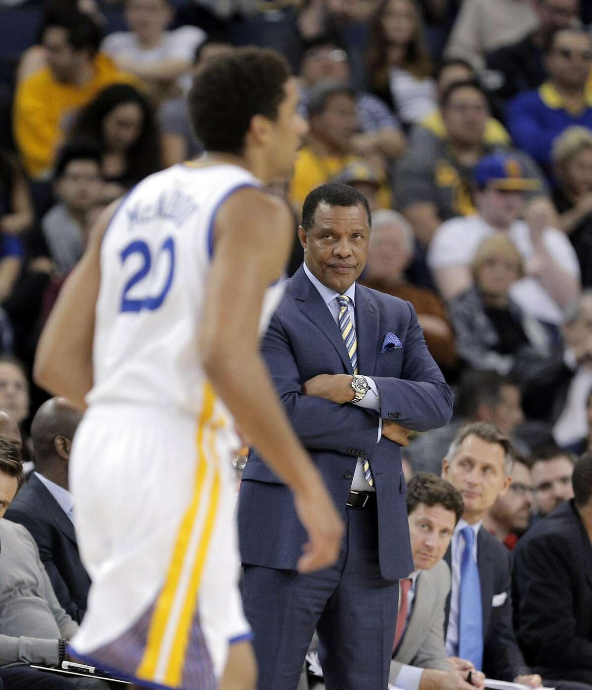 Pelicans head coach Alvin Gentry watches James Michael McAdoo (20) dribble up court in the second half as the Golden State Warriors played the New Orleans Pelicans at Oracle Arena in Oakland, Calif., on Monday, March 14, 2016.