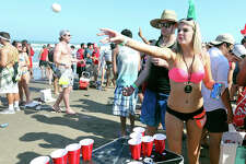 Spring Breakers Evan McCullough, from Lubbock, TX, (left) and Shannon Solomon, from Dallas, TX,  play beer pong Sunday March 13, 2016on South Padre Island, Tx.