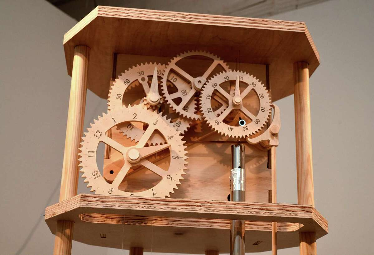 """""""Going on Going"""" by Justin Boyd is a mechanical clock of wood, copper and other materials."""