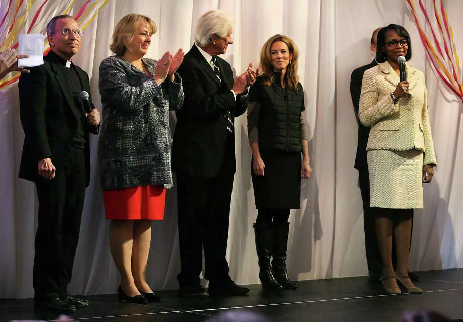 Members of the Tricentennial Commission Fr. David Garcia, from left, Dr. Katie Luber, Lionel Sosa and Renee Flores of AT&T listen to San Antonio Mayor Ivy Taylor as city, county, and civic leaders gather at the Tobin Center for the kick-off and unveiling of the official Tricentennial logo on Wednesday, Jan. 27, 2016. Photo: BOB OWEN, Staff / San Antonio Express-News / San Antonio Express-News
