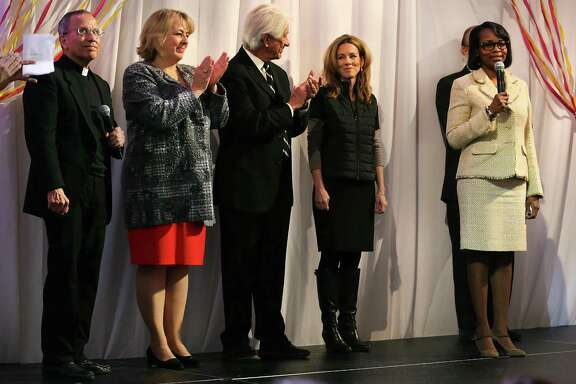 Members of the Tricentennial Commission Fr. David Garcia, from left, Dr. Katie Luber, Lionel Sosa and Renee Flores of AT&T listen to San Antonio Mayor Ivy Taylor as city, county, and civic leaders gather at the Tobin Center for the kick-off and unveiling of the official Tricentennial logo on Wednesday, Jan. 27, 2016.