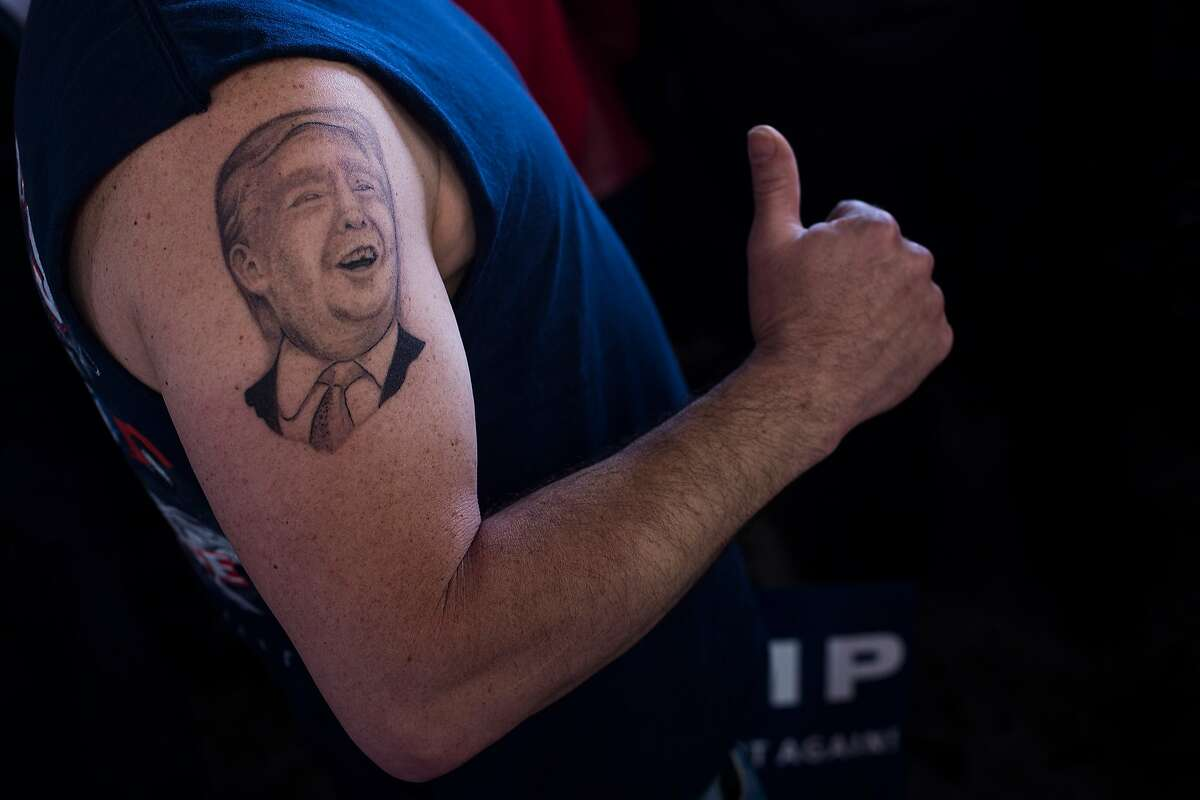 Anthony Bordell, 44, of Howland Ohio, stands waiting with a 2 week old tattoo of republican presidential candidate Donald Trump before Trump speaks at a campaign event at the Winner Aviation in Vienna, Ohio on Monday March 14, 2016.