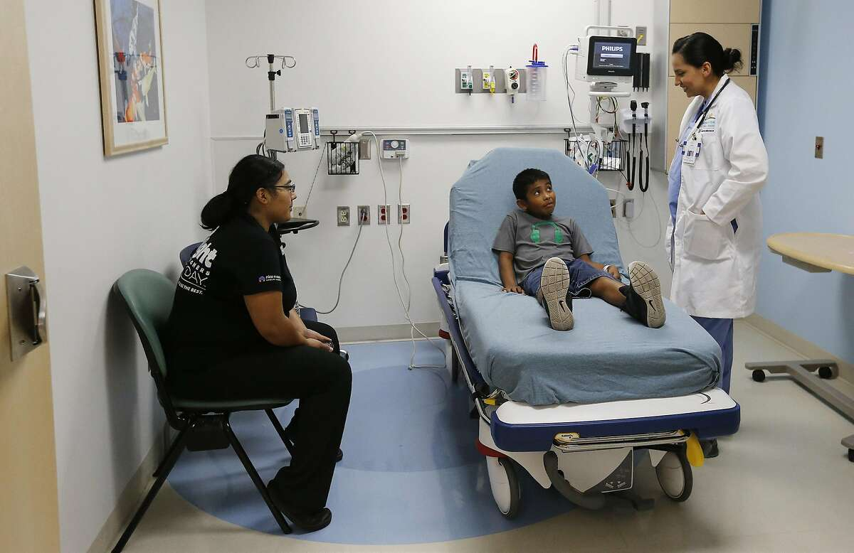 Resident pediatric physician Danielle Ramirez (right) meets with Jonathan Banuelos, 9, and his mother, Stephanie Vela, at the Children's Hospital of San Antonio formerly Santa Rosa Hospital in downtown San Antonio. The hospital caters to treating children but is still a Level III trauma facility in case of emergencies. Renovations are still underway at the hospital which has been treating patients since 1849 when an outbreak of cholera occurred in the city. (Kin Man Hui/San Antonio Express-News)