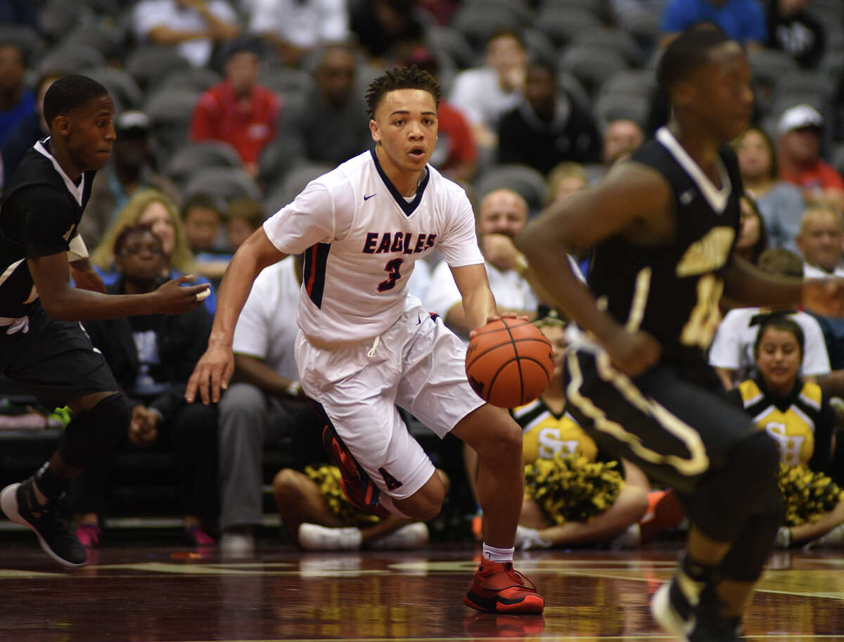 Atascocita senior guard Carsen Edwards (3) works the ball on a fast break against Sam Houston during fourth quarter action of their Class 6A boys basketball state semifinal matchup at the Alamodome in San Antonio on Friday, Mar. 11, 2016. (Photo by Jerry Baker/Freelance)