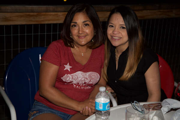 Mellisa Flores and Veronica Lewis are at Hills & Dales Ice House.