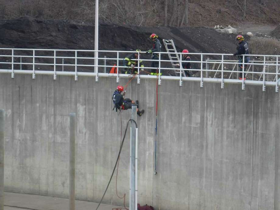 "Danbury firefighters rescue ""an injured worker"" from the bottom of a reservoir during a drill Friday at the Public Utilities' facility. Photo: Contributed"