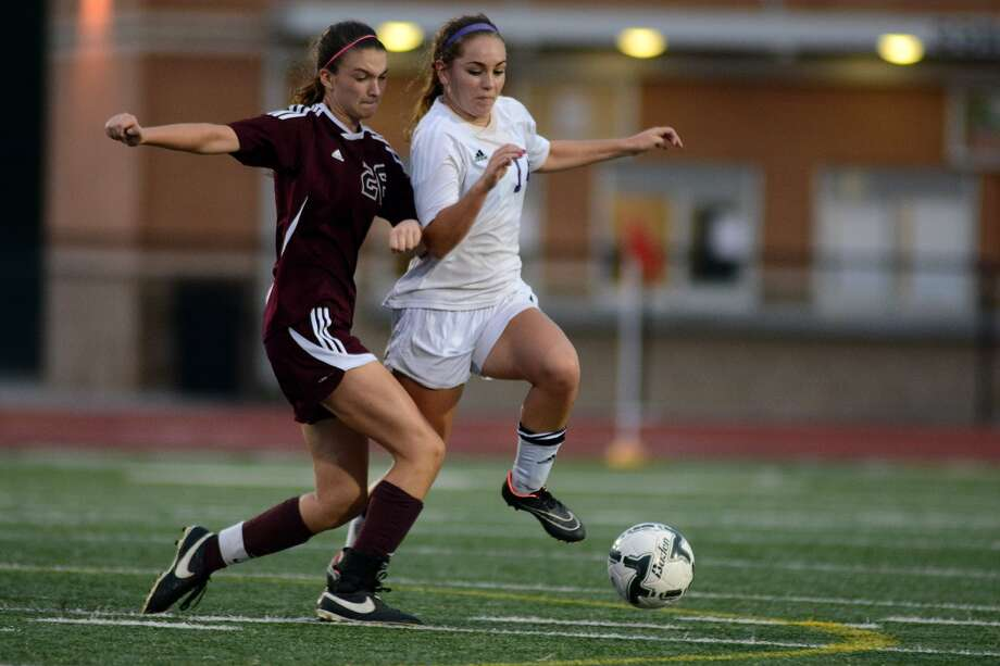 Magnolia forward Brooke Bowie, left, and the Bulldogs are fighting to stage an extended run in the UIL Class 6A soccer playoffs. Photo: Jerry Baker, Freelance