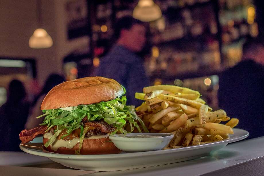 Michael Bauer's favorite? The Marlowe Burger at Marlowe in S.F., on an Acme bun with caramelized onions, cheese, lettuce, bacon and horseradish aioli. Photo: John Storey / Special To The Chronicle