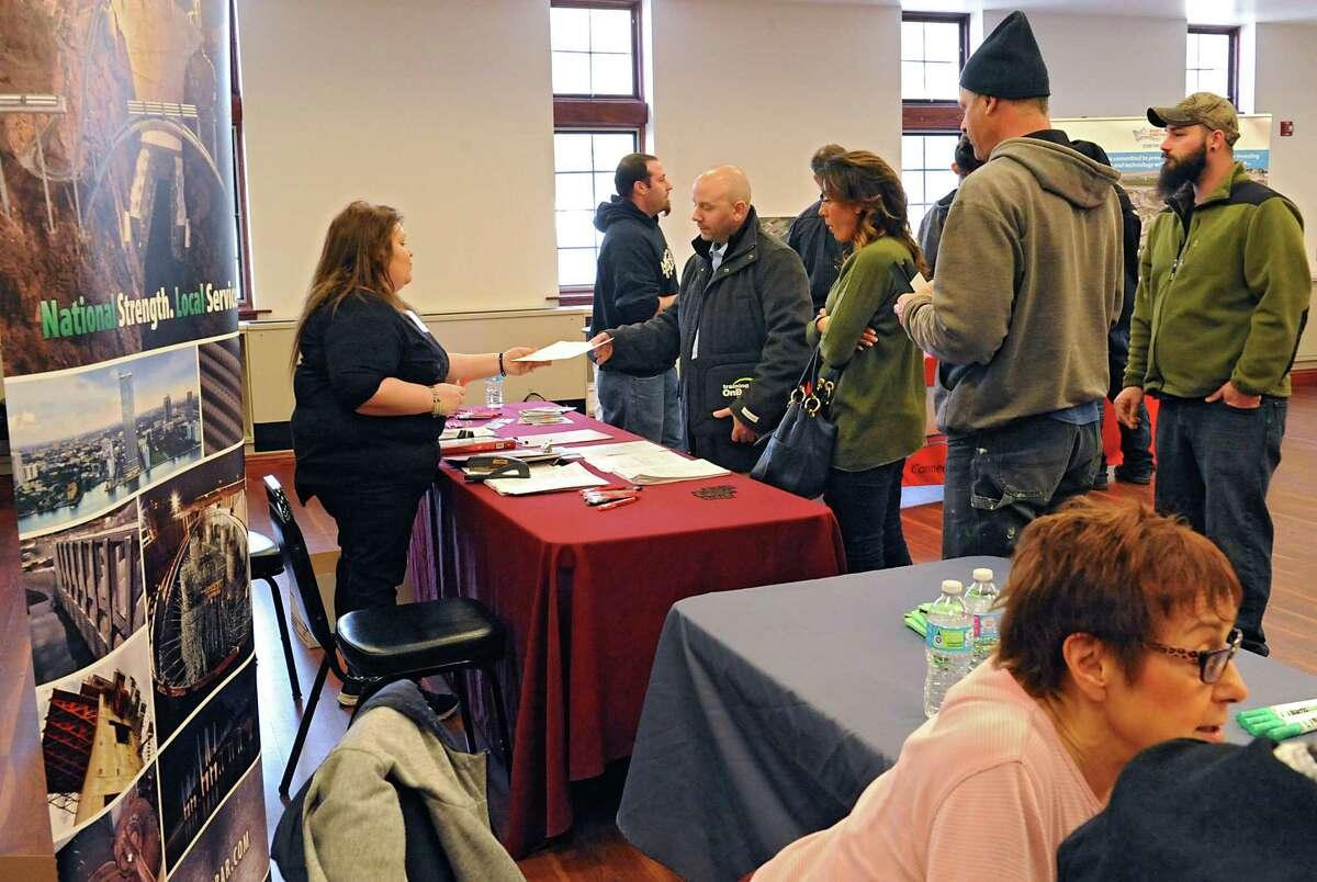 Job seekers talk to representatives as the Port of Coeymans and the Coeymans Industrial Park host a job fair at the Coeymans Fire Department Tuesday, March 15, 2016 in Coeymans, N.Y. (Lori Van Buren / Times Union)