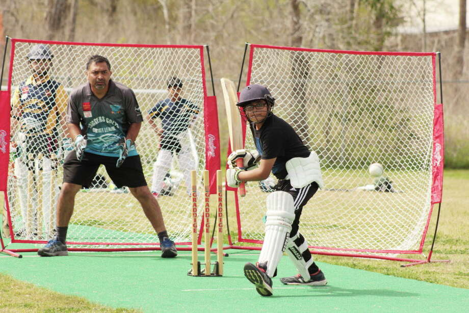 Sugar Land Youth Cricket Club player Ahmed Salman, 12, takes a turn hitting the ball at the practice field in Stafford.Sugar Land Youth Cricket Club player Ahmed Salman, 12, takes a turn hitting the ball at the practice field in Stafford. Photo: Jimmy Loyd  / freelance