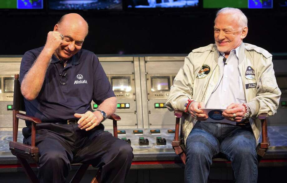 Former NASA astronaut, Buzz Aldrin, right and ESPN college basketball analyst, Dick Vitale, right, pick their NCAA tournament brackets as part of the fourth annual Allstate March Mayhem Challenge at Space Center Houston on Tuesday, March 15, 2016 in Houston, TX.  The picks were moderated by Mike Wamplee. Aldrin and Vitale both picked Michigan State to win the Final Four, ( Photo by Thomas B. Shea / For the Chronicle) Photo: Thomas B. Shea, Contract Photographer / Thomas Shea