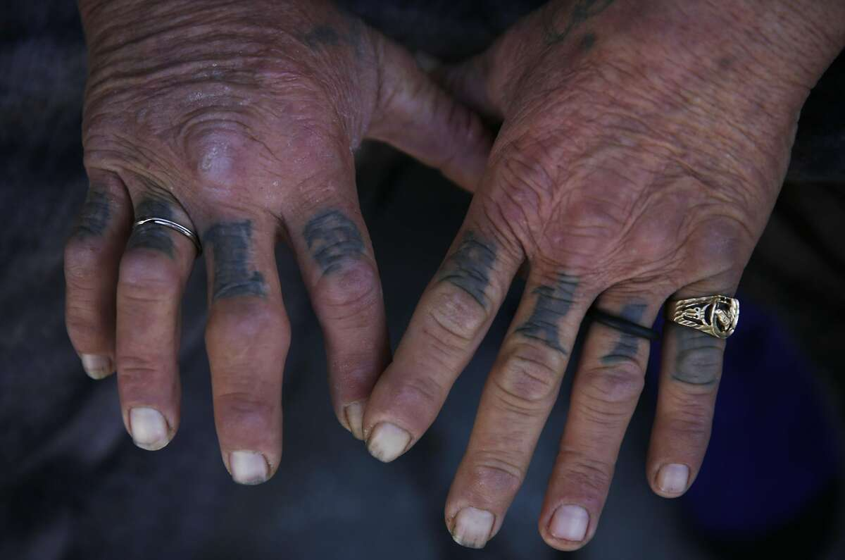 A man who has been homeless for 15 years and who preferred not to be named shows his worn hands for a photograph March 15, 2016 in San Francisco, Calif.