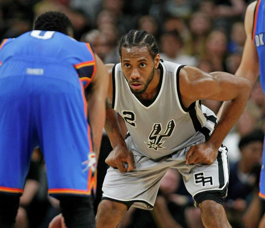 SAN ANTONIO,TX - MARCH 12: Kawhi Leonard #2 of the San Antonio Spurs focus on defense against the Oklahoma City Thunder at AT&T Center on March 12, 2016 in San Antonio, Texas.  NOTE TO USER: User expressly acknowledges and agrees that , by downloading and or using this photograph, User is consenting to the terms and conditions of the Getty Images License Agreement. Photo: Ronald Cortes, Getty Images / 2016 Getty Images